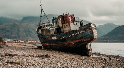Corpach Shipwreck( Old boat of Caol )with Ben Nevis in the background, Scotland